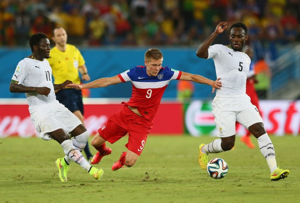 NATAL, BRAZIL - JUNE 16: Aron Johannsson of the United States is challenged by Sulley Muntari (L) and Michael Essien of Ghana during the 2014 FIFA World Cup Brazil Group G match between Ghana and the United States at Estadio das Dunas on June 16, 2014 in Natal, Brazil.  (Photo by Kevin C. Cox/Getty Images)