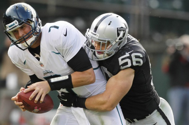 October 21, 2012; Oakland, CA, USA; Jacksonville Jaguars quarterback Chad Henne (7) is sacked by Oakland Raiders outside linebacker Miles Burris (56) in the third quarter at O.co Coliseum. The Raiders defeated the Jaguars 26-23 in overtime. Mandatory Credit: Cary Edmondson-US PRESSWIRE
