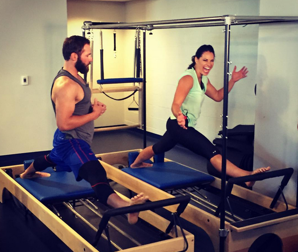 ESPN Baseball Analyst Jessica Mendoza takes a Pilates lesson from Cubs pitcher Jake Arrieta